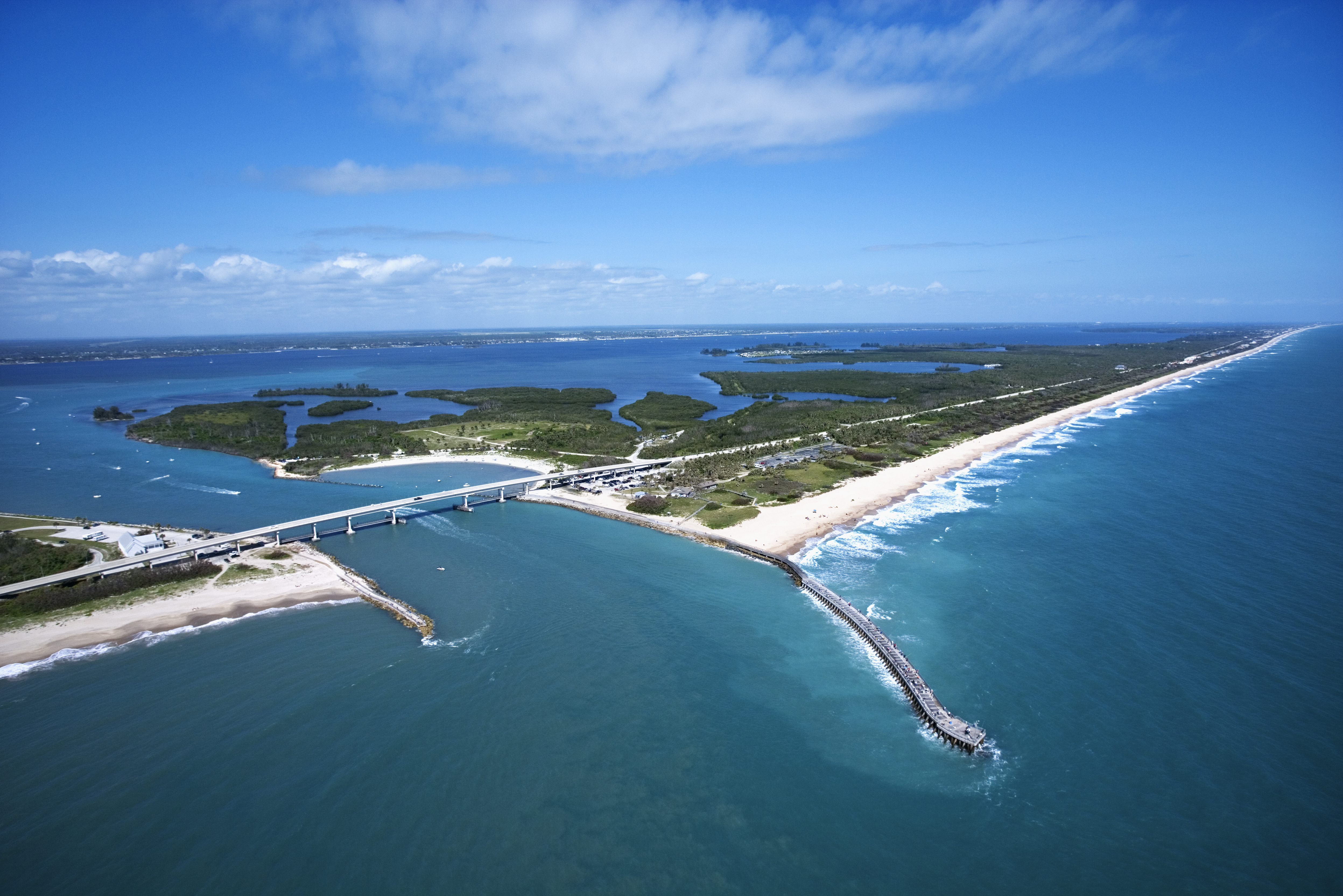 Aerial view of Indian River Lagoon Scenic Highway on Melbourne Beach Florida with inlet and pier.